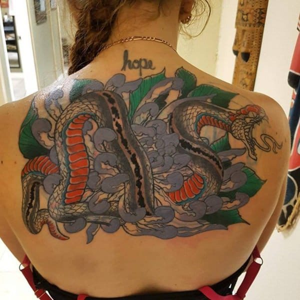 54ff7cf4306e8 A person who conquers a debilitating disease like cancer deserves a koi  fish tattoo.