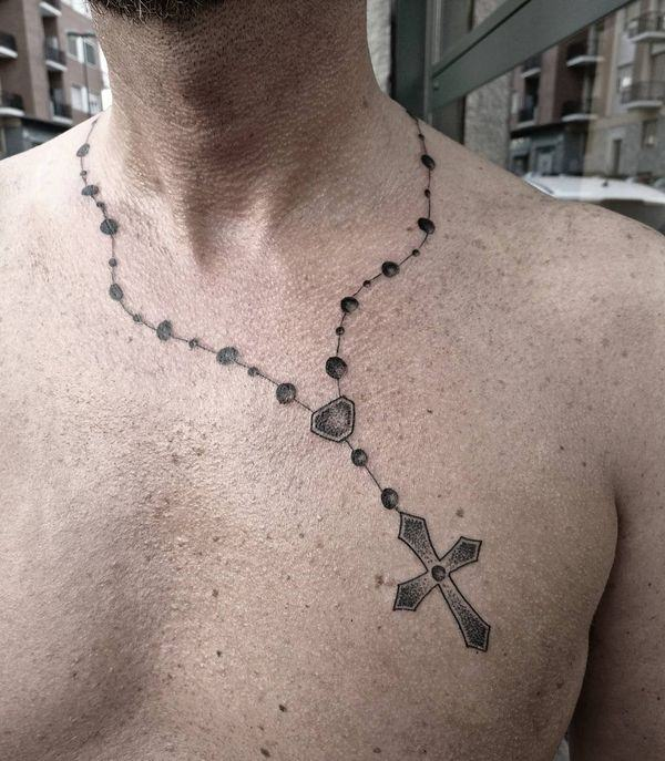 8dfa36ec0 Aside from aesthetics, tattoos hold a deeper meaning for the wearer.  Understanding what the rosary tattoo signifies will better help you decide  whether this ...