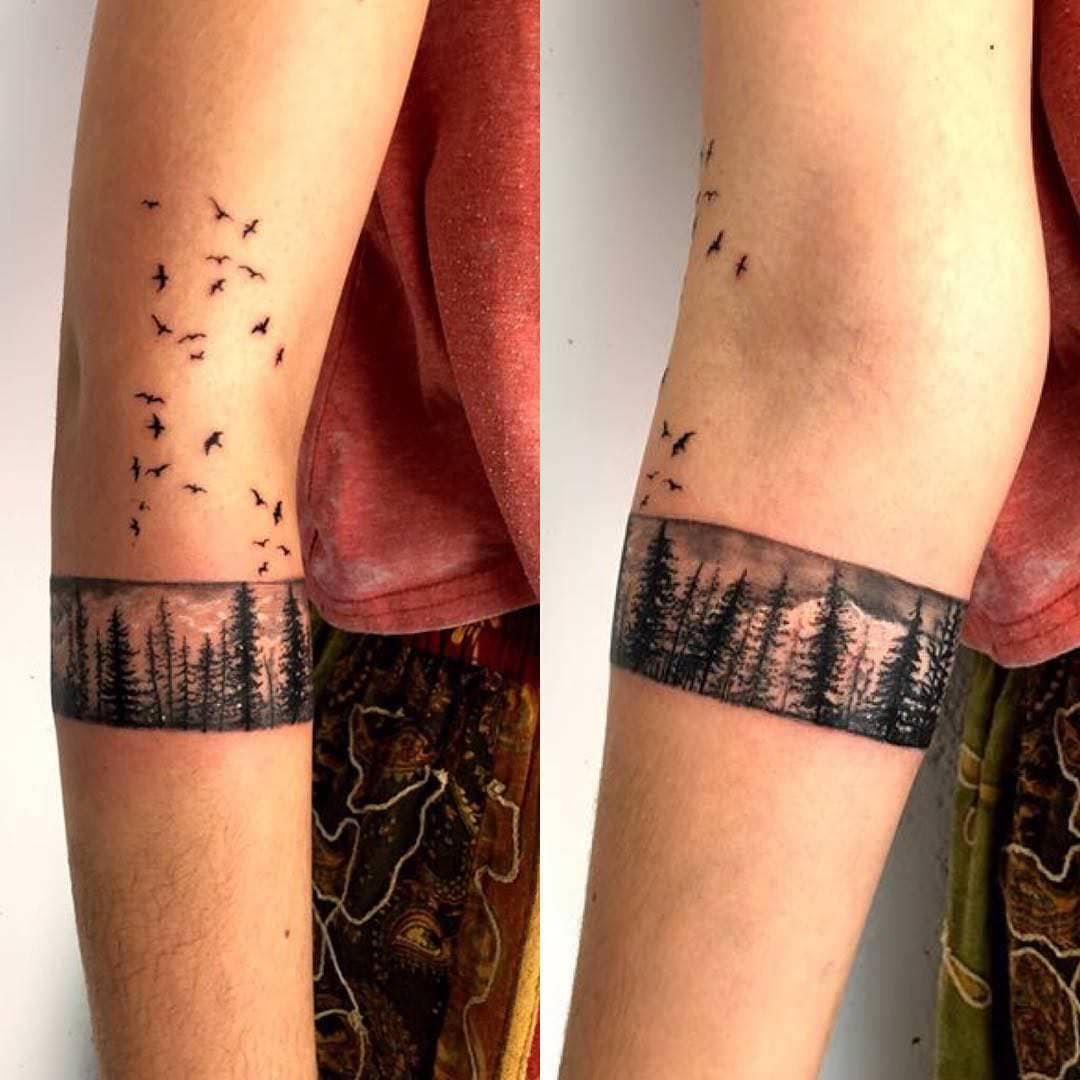 f4cea3538 The leaves' string creates a fence around tattoo design and appears as  mountains are ready to fly.