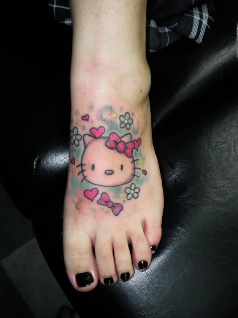 hello kitty ribbon tattoo