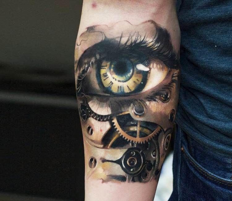 mechanical eye forearm tattoo