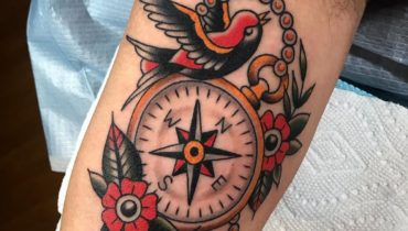 swallo and compass tattoo