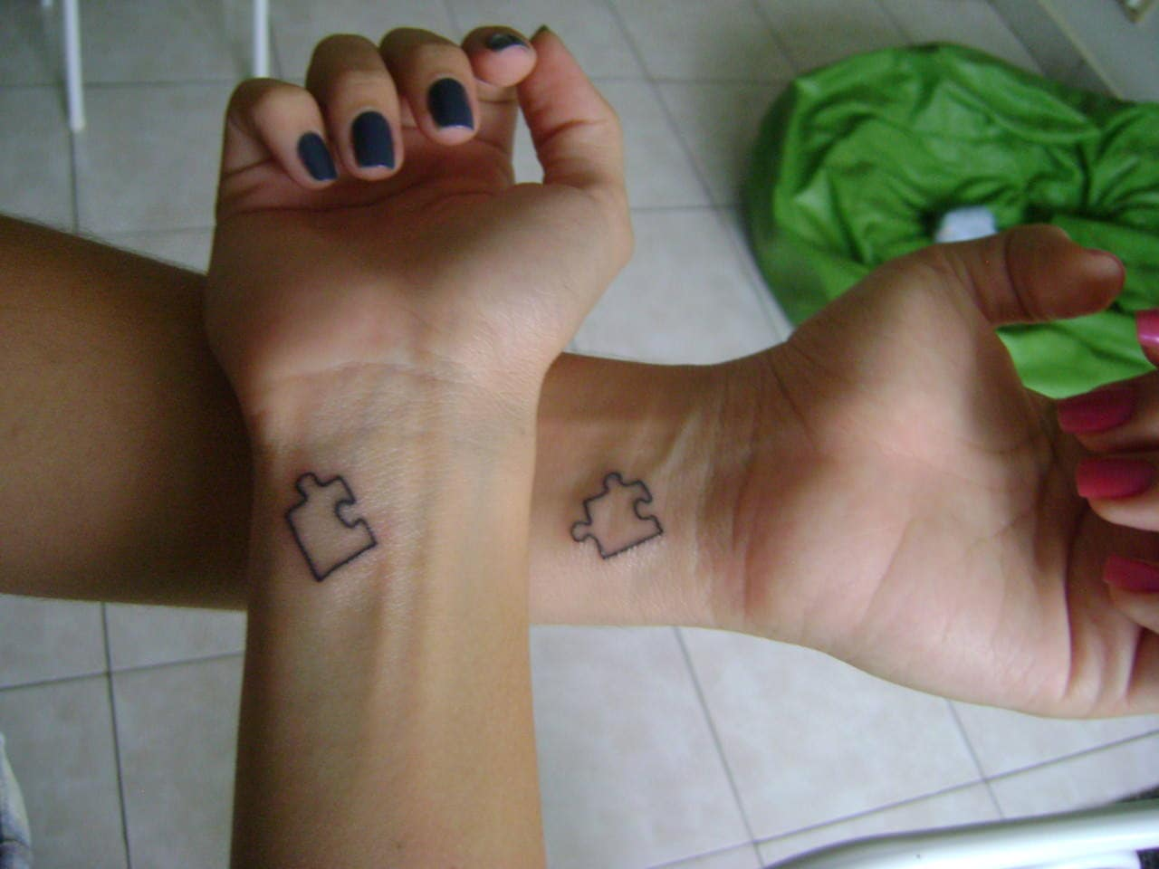 Jigsaw puzzle tattoos couple