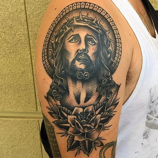 jesus arm tattoo